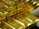 Златото леко поевтиня след ръст от 9 % за последната седмица